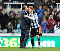 Jack Colback of Newcastle United celebrates at the final whistle with Rafa Benitez manager of Newcastle United during the Barclays Premier League match between Newcastle United and Swansea City played at St. James' Park, Newcastle upon Tyne, on the 16th April 2016