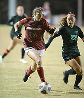 NWA Democrat-Gazette/ANDY SHUPE<br /> Arkansas' Taylor Malham (14) pushes the ball past North Texas' Berklee Peters Friday, Nov. 15, 2019, during the second half of play in the first round of the NCAA women's soccer tournament at Razorback Field in Fayetteville. Visit nwadg.com/photos to see more photographs from the match.