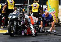 Jun. 2, 2013; Englishtown, NJ, USA: NHRA crew member lines up the bike of pro stock motorcycle rider Shawn Gann during the Summer Nationals at Raceway Park. Mandatory Credit: Mark J. Rebilas-