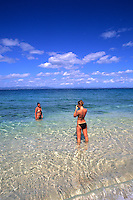 Tourists on South Sea Island Beach and Crystal Clear Water in the Fiji Islands