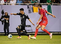 CHICAGO, IL - JULY 7: Uriel Antuna #22 attacks with Aaron Long #23 defending during a game between Mexico and USMNT at Soldiers Field on July 7, 2019 in Chicago, Illinois.