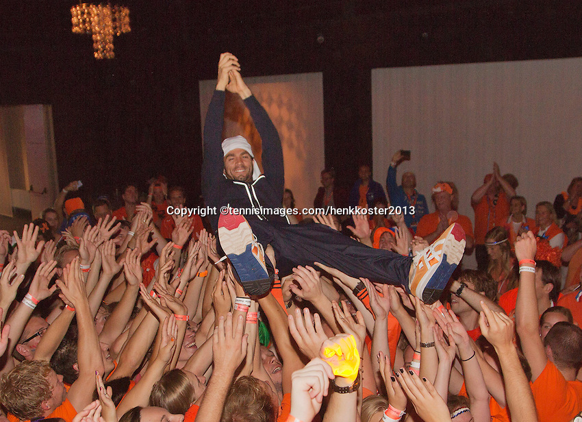 14-sept.-2013,Netherlands, Groningen,  Martini Plaza, Tennis, DavisCup Netherlands-Austria, ,  Dutch Team celebration with students , Jean-Julien Rojer is crowdsurfing<br /> Photo: Henk Koster