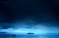 Sailboat and an Island.  Severe Storm Approaching.