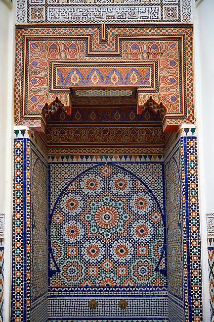 Berber Arabesque Morcabe plasterwok Zellige tiles of a fountain in the Marrakesh museum in the Dar Menebhi Palace, Marrakesh, Morocco