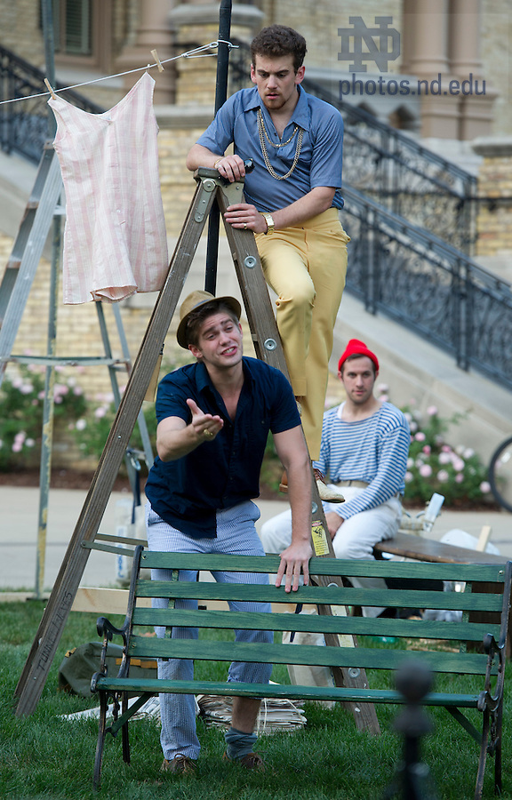 """Aug, 26, 2013; Actors from the Young Company, Nathan Goodrich, Joey Doyle and Ryan Belock perform in Shakespeare's """" The Comedy of Errors"""" on the Main Building Quad (in front of the Golden Dome). Photo by Barbara Johnston/University of Notre Dame"""