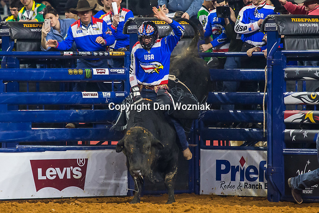Professional Bull Riders in action during the WinStar Casino and Resort PBR Global Cup bull riding event, at the AT & T stadium in Arlington, Texas.