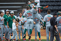 Chad Crosbie (35) of the Miami Hurricanes celebrates with teammate Tony Jenkins (51) after hitting a 3-run home run against the Wake Forest Demon Deacons at David F. Couch Ballpark on May 11, 2019 in  Winston-Salem, North Carolina. The Hurricanes defeated the Demon Deacons 8-4. (Brian Westerholt/Four Seam Images)
