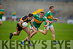 Austin Stacks Paul O'Sullivan been well marked by Michael Walsh of John Mitchels in the Tralee Town Board Senior Football Championship final.