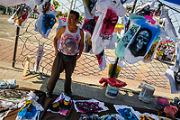 A Mexican man sells t-shirts, featuring various Santa Muerte (Holy Death) pictures, on the street during a religious pilgrimage in Tepito, Mexico City, Mexico, 1 April 2018. The religious cult of Santa Muerte is a fusion of Aztec death worship rituals and Catholic beliefs. Born in lower-class neighborhoods of Mexico City, it has always been closely associated with crime. In the past decades, original Santa Muerte followers, such as prostitutes, pickpockets and street drug traffickers, have merged with thousands of ordinary Mexican Catholics. The Holy Death veneration, offering a spiritual way out of hardship in modern society, rapidly expanded. Although the Catholic Church still considers Santa Muerte followers the devil worshippers, on the first day of every month, crowds of Santa Muerte believers fill the streets of Tepito. Holding statues of Holy Death clothed in a long robe, they pray for healing, protection, money or any other favor in life.