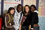 Group of 4 high school students posing in corridor