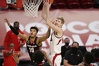 Arkansas forward Connor Vanover (23) rebounds the ball as Georgia Toumani Camara (10) blocks, Saturday, January 9, 2021 during the first half of a basketball game at Bud Walton Arena in Fayetteville. Check out nwaonline.com/210110Daily/ for today's photo gallery. <br /> (NWA Democrat-Gazette/Charlie Kaijo)