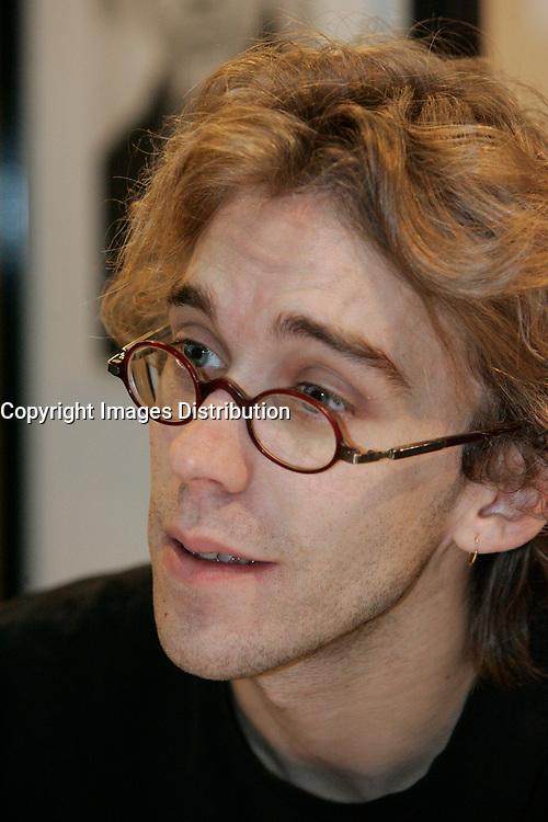 Montreal (Qc) CANADA, NOvember 2005 File Photo<br /> <br /> Fred Pellerin at the Salon du Livre de Montreal.<br /> <br /> Fred Pellerin est un conteur québécois originaire de Saint-Élie-de-Caxton, dans la région de la Mauricie, et diplômé de l'Université du Québec à Trois-Rivières. Ses histoires ont comme cadre son village natal de Saint-Élie et mettent en scène des personnages de l'endroit : Toussaint Brodeur, Ésimésac Gélinas. Il dit tenir ses contes, ou du moins s'être inspiré, des histoires de sa grand-mère ou des autres habitants de Saint-Élie-de-Caxton.<br /> photo : (c) images Distribution