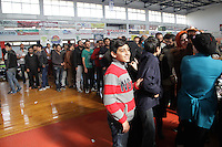 Pictured: Migrants queueing up in Ierapetra basketball arena. Friday 28 November 2014<br />