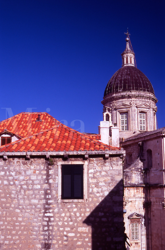 Croatia. Dubrovnik Old Town. Old building with Terracotta roof tiles and the Cathedral of the Assumption of the Virgin Mary.