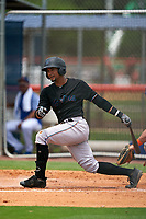 GCL Marlins Walner Espinal (14) at bat during a Gulf Coast League game against the GCL Mets on August 11, 2019 at St. Lucie Sports Complex in St. Lucie, Florida.  The Marlins defeated the Mets 3-2 in the second game of a doubleheader.  (Mike Janes/Four Seam Images)