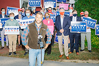 With an American flag bandana in his back pocket or around his neck (used as an anti-COVID facemask when not in front of cameras), John Pence, nephew of Vice President Mike Pence and a 2020 Trump campaign senior advisor, speaks to local New Hampshire media during a visit with campaign volunteers and supporters outside the office of the New Hampshire Republican State Committee in Concord, New Hampshire, on Wed., Sept. 16, 2020. John Pence spoke to the crowd about the importance of their get out the vote efforts in securing a reelection victory for Donald Trump and Mike Pence.