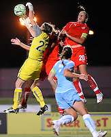 Sky Blue FC goalkeeper Jenni Branam (23) battles for the ball with Allie Long (9) and Abby Wambach (20) of the Washington Freedom. Sky Blue FC and the Washington Freedom played to a 4-4 tie during a Women's Professional Soccer match at Yurcak Field in Piscataway, NJ, on July 15, 2009.