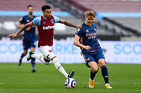 21st March 2021; London Stadium, London, England; English Premier League Football, West Ham United versus Arsenal; Jesse Lingard of West Ham United challenges Martin Odegaard of Arsenal