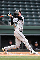 Right fielder Tyler Lesch (2) of the USC Upstate Spartans bats in a game against the Furman University Paladins on Tuesday, March 4, 2013, at Fluor Field at the West End in Greenville, South Carolina. Furman won, 13-1. (Tom Priddy/Four Seam Images)