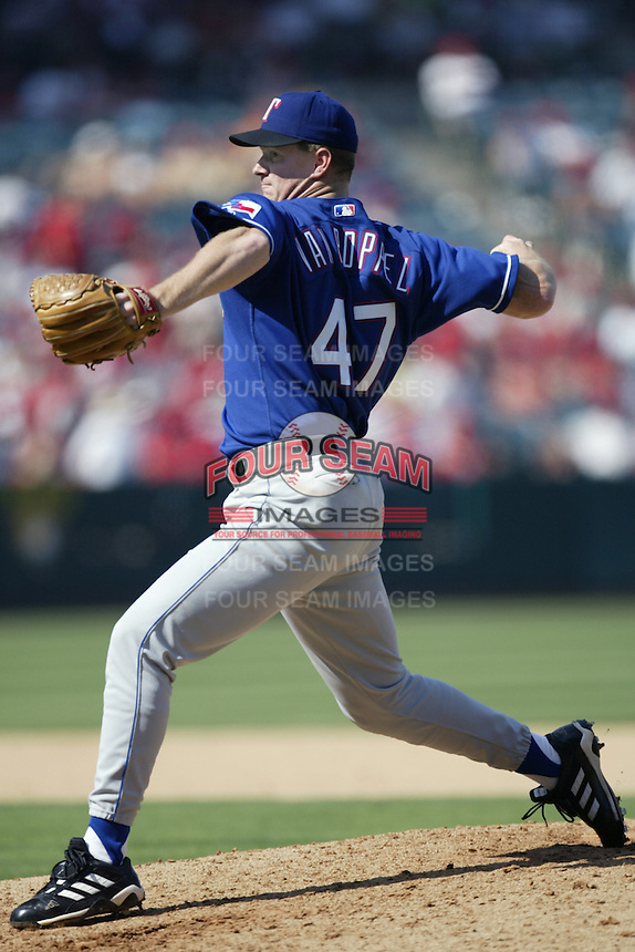 Todd Van Poppel of the Texas Rangers pitches during a 2002 MLB season game against the Los Angeles Angels at Angel Stadium, in Los Angeles, California. (Larry Goren/Four Seam Images)