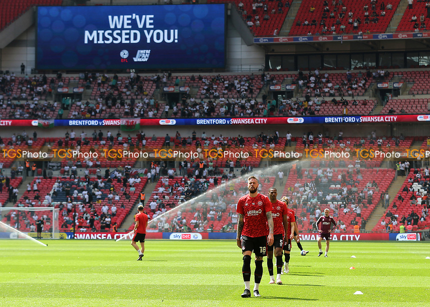 The Big Screen displays a message, We've Missed You, as the fans start to arrive and Brentford players commence their pre-match warm up during Brentford vs Swansea City, Sky Bet EFL Championship Play-Off Final Football at Wembley Stadium on 29th May 2021