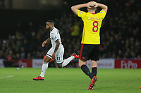 (L-R) Luciano Narsingh of Swansea City celebrates his goal to the disappointment of Tom Cleverley of Watford during the Premier League match between Watford and Swansea City at the Vicarage Road, Watford, England, UK. Saturday 30 December 2017