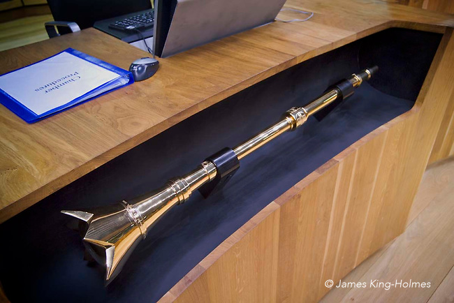 The ceremonial mace kept in front of the Presiding Officer's desk in the Senedd of the National Assembly for Wales. It was made from gold, silver and brass by Fortunato Rocca in Melbourne, Australia.