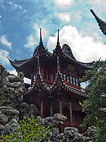 Fascinating archtecture abounds.  the stone formations are sculptures designed to bring one closer to nature.  Yu Gardens, a peaceful place to escape the bustle of Shanghai.  Full of visitors, still very calming.  Details in the buildings, doors and stone sculptures.  Helps get your Ying and Yang in balance.