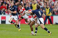 Japan Number 8 Amanaki Mafi is tackled by Scotland Scrum-Half Greig Laidlaw - Mandatory byline: Rogan Thomson - 23/09/2015 - RUGBY UNION - Kingsholm Stadium - Gloucester, England - Scotland v Japan - Rugby World Cup 2015 Pool B.