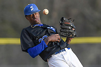 Pitcher Jordan Jackson (32) of the Spartanburg Methodist College Pioneers ducks to get out of the way of a batted ball during Game 2 of a junior college season-opening doubleheader against the Patrick Henry Patriots on February 3, 2018, at Mooneyham Field in Spartanburg, South Carolina. (Tom Priddy/Four Seam Images)