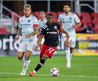 WASHINGTON, DC - MAY 13: Moses Nyeman of D.C. United dribbles during a game between Chicago Fire FC and D.C. United at Audi FIeld on May 13, 2021 in Washington, DC.