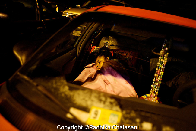 WISE, VIRGINIA-JULY 26: Dayshai (13) Goff sleeps in her mother's car outside the Virginia-Kentucky Fairgrounds to receive free medical care when the gates open at 5:30am at the free makeshift clinic provided by Remote Area Medical (RAM) Expedition July 26, 2009. RAM, operating in 5 states this year as well as overseas, provides free medical, dental and vision care to people in need. Organizers estimate that they spent $250,000 USD to  providedover $1.6 million USD worth of care..