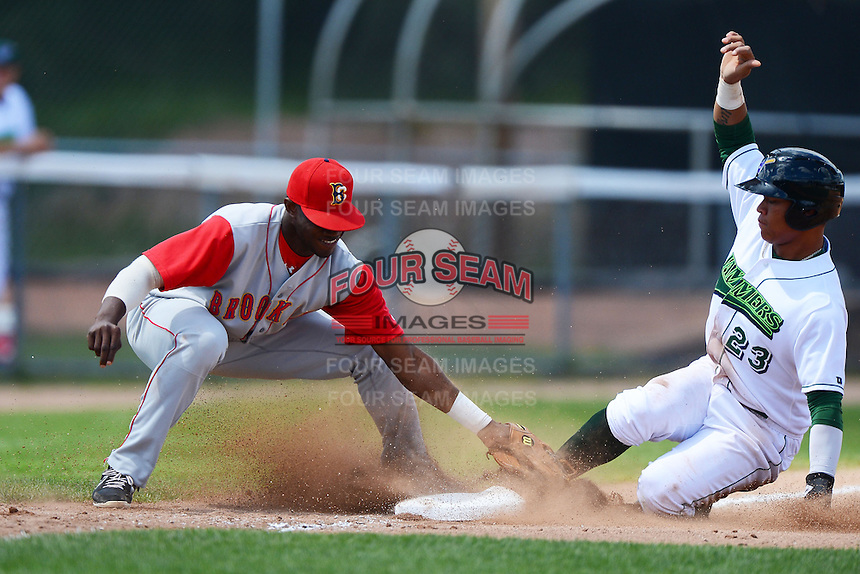 Brooklyn Cyclones third baseman Anthony Chavez (48) tags out Harold Ramirez (23) sliding into third during a game against the Jamestown Jammers on August 4, 2013 at Russell Diethrick Park in Jamestown, New York.  Jamestown defeated Brooklyn 9-5.  (Mike Janes/Four Seam Images)