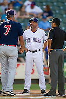 Round Rock Express coach Spike Owen (11) exchanges lineup cards with Oklahoma City RedHawks coach Leon Roberts (7) before the Pacific Coast League baseball game on August 25, 2013 at the Dell Diamond in Round Rock, Texas. Round Rock defeated Oklahoma City 9-2. (Andrew Woolley/Four Seam Images)