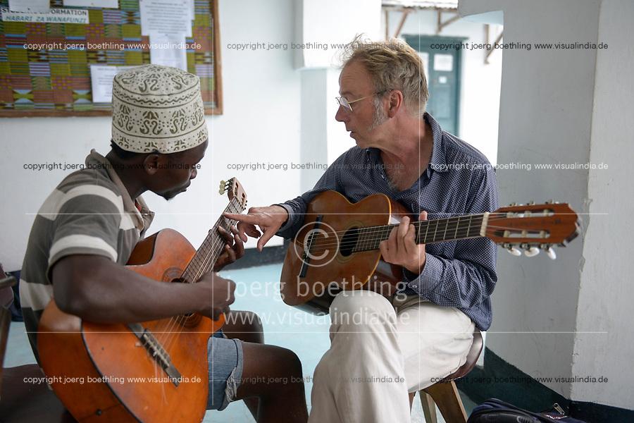 TANZANIA, Zanzibar, Stone town, Dhow countries music academy, Zanzibari music student and western guitar player play together guitar and exchange knowledge