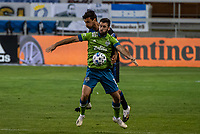 SAN JOSE, CA - OCTOBER 18: Cristian Roldan #7 of the Seattle Sounders protects the ball during a game between Seattle Sounders FC and San Jose Earthquakes at Earthquakes Stadium on October 18, 2020 in San Jose, California.