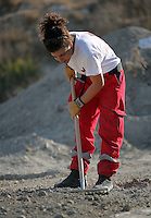 Pictured: A Hellenic Red Cross volunteer uses a rake to search through soil in a field in Kos, Greece. Tuesday 04 October 2016<br /> Re: Police teams led by South Yorkshire Police, searching for missing toddler Ben Needham on the Greek island of Kos have moved to a new area in the field they are searching.<br /> Ben, from Sheffield, was 21 months old when he disappeared on 24 July 1991 during a family holiday.<br /> Digging has begun at a new site after a fresh line of inquiry suggested he could have been crushed by a digger.