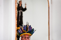 """A native from the Kamentsá tribe, wearing a colorful feather headgear, participates in the Catholic mass during the Carnival of Forgiveness, a traditional indigenous celebration in Sibundoy, Colombia, 12 February 2013. Clestrinye (""""Carnaval del Perdón"""") is a ritual ceremony kept for centuries in the Valley of Sibundoy in Putumayo (the Amazonian department of Colombia), a home to two closely allied indigenous groups, the Inga and Kamentsá. Although the festival has indigenous origins, the Catholic religion elements have been introduced and merged with the shamanistic tradition. Celebrating annually the collaboration, peace and unity between tribes, they believe that anyone who offended anyone may ask for forgiveness this day and all of them should grant pardons."""