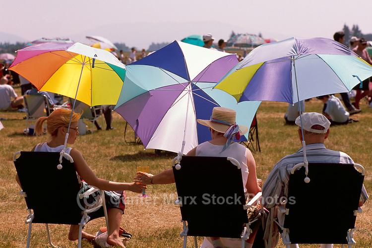 Spectators watching Air Show under Sun Umbrellas - at Abbotsford International Airshow, BC, British Columbia, Canada