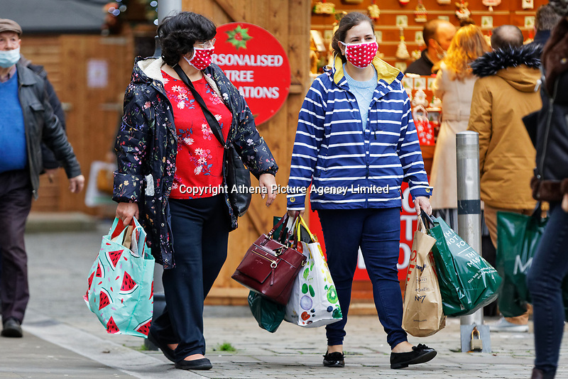 Pictured: Shoppers wearing facemasks in Oxford Street, in the city centre of Swansea, Wales, UK. Monday 30 November 2020<br /> Re: Pubs and restaurants will have to stop serving alcohol shut at 6pm from this Friday due to the Covid-19 Coronavirus pandemic, Wales, UK.