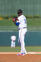 Surprise Saguaros relief pitcher Demarcus Evans (30), of the Texas Rangers organization, gets ready to deliver a pitch during an Arizona Fall League game against the Peoria Javelinas at Surprise Stadium on October 17, 2018 in Surprise, Arizona. (Zachary Lucy/Four Seam Images)