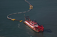 aerial photograph of the H. R. Morris Manson Construction cutter suction dredge operating in  Oceanside Harbor, Oceanside, San Diego County, California