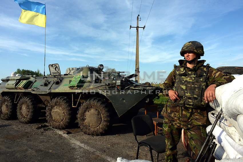 A Ukrainian soldier stands guard at a check point near Slavyansk.  Donetsk region.