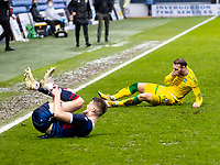13th March 2021; Global Energy Stadium, Dingwall, Highland, Scotland; Scottish Premiership Football, Ross County versus Hibernian; Martin Boyle of Hibernian slides in to tackle Leo Fuhr Hjelde of Ross County