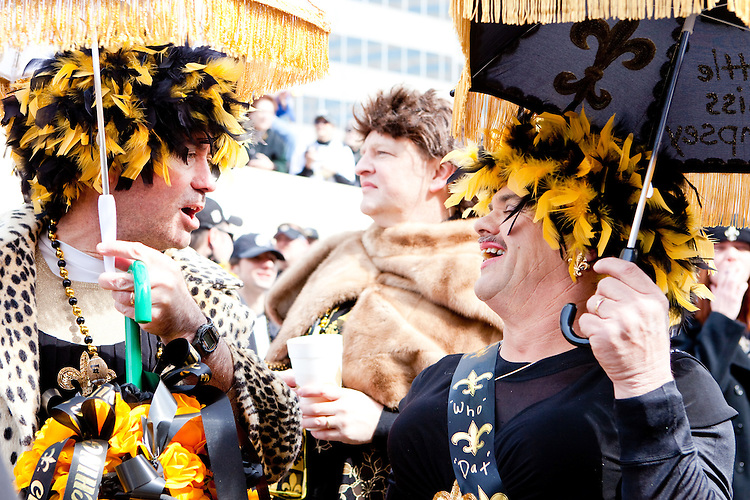 """Tim Napier (L) and Melvin Bodenheimer at a parade held in Buddy D's honor on January 31, 2010 in New Orleans.<br /> <br /> Thousands of Saints fans wearing dresses paraded from the Louisiana Superdome to the French Quarter to honor a promise made by the late sportscaster and Saints super-fan Buddy Diliberto aka """"Buddy D"""".<br /> <br /> In 1993 Buddy D, who passed away in 2005, remarked on air that if the Saints were to make it to the Super Bowl, he would wear a dress and dance down the streets.  The comment was repeated at various times and never forgotten by his listeners.<br /> <br /> Led by former New Orleans Saints quarterback Bobby Hebert, who has taken Buddy D's place on WWL radio, thousands made good on his promise for him, dancing, drinking, and cavorting their way down the street, alternately yelling out """"Who Dat!"""" and """"Buddy D!"""" in front of an onlooking crowd an estimated 85,000 people strong.<br /> <br /> The hard luck NFL team the New Orleans Saints has reached its first Super Bowl in team history, after 43 years largely filled with losing seasons and futility.  It is difficult to travel anywhere in the area without some reminder of this fact, as the team and city are intertwined perhaps like no other sports franchise in this country."""