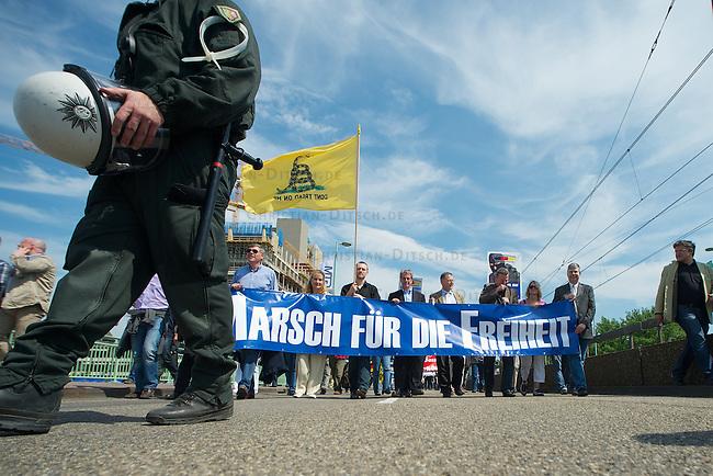 """""""Marsch fuer die Freiheit"""" von Pro Koeln und Pro-NRW.<br /> Etwa 300 Rechtspopulisten kamen am Samstag den 7. Mai 2011 aus deutschland, Italien, Belgien ind Frankreich zu einem sog. """"Marsch fuer die Feiheit"""" nach Koeln zu dem die Rechtspopulisten von Pro Koeln und Pro-NRW sowie die rechtsextremen Republikaner aufgerufen hatten. Mit der Demonstration sollte gegen eine angebliche Islamisierung Europas protestiert werden. Die Demonstration wurde von lautstarken Protesten begleitet und musste nach einer Zwischenkundgebung wegen verschiedener Sitzblockaden durch koelner Buerger und diverse antifaschistische Gruppen abgebrochen werden.<br /> Im Bild am Leittransparent vlnr.: Filip Dewinter, Vlaams Belang (Belgien); Susanne Winter, FPOe (Oesterreich); Taylor Rose, Vorsitzender des Youth for Western Civilization und Tea Party (USA); Jacques Cordonnier; Bloc Identitaire (Frankreich); Rolf Schlierer, Republikaner (Deutschland); Markus Beisicht, Pro Koeln und Pro NRW (Deutschland); ?; Manfred Rouhs, Pro Deutschland.<br /> 7.5.2011, Koeln<br /> Foto: Christian-Ditsch.de<br /> [Inhaltsveraendernde Manipulation des Fotos nur nach ausdruecklicher Genehmigung des Fotografen. Vereinbarungen ueber Abtretung von Persoenlichkeitsrechten/Model Release der abgebildeten Person/Personen liegen nicht vor. NO MODEL RELEASE! Don't publish without copyright Christian-Ditsch.de, Veroeffentlichung nur mit Fotografennennung, sowie gegen Honorar, MwSt. und Beleg. Konto:, I N G - D i B a, IBAN DE58500105175400192269, BIC INGDDEFFXXX, Kontakt: post@christian-ditsch.de]"""