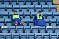 A cold day for two of the Gillingham substitutes as they social distance in the stand during Gillingham vs Oxford United, Sky Bet EFL League 1 Football at the MEMS Priestfield Stadium on 10th October 2020