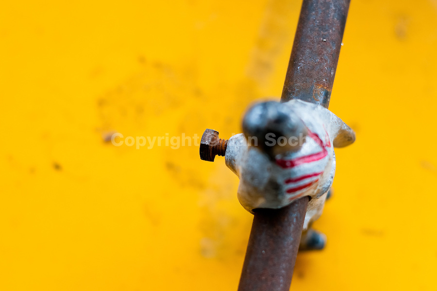A table football player figure, mounted on a rusted bar, is seen inside the table football box on the street of Olmedo, a small village in the mountains of Ecuador, 27 June 2010. Table football, also known as futbolin in Latin America, is a widely popular table-top game in Ecuador. During the annual fairs, the rusty old outdoor-designed tables, fully ocuppied by excited children, may be found on all public places, particularly on the squares and in the parks. Human players use figures mounted on rotating bars to kick the small plastic ball into the opposing goal. Each team of 1 or 2 human players controls 4 rows on its side of the table. The game ends when one team scores a predetermined number of goals. In 2002, the International Table Soccer Federation (ITSF) was established to promote the sport of table football.
