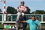 25-1 longshot Tune Me In with Paco Lopez wins the Oceanport Stakes for 3-year olds & up going 1 1/16 on the turf. Trainer Bruce Alexander.  Owner Patricia Generazio