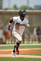 GCL Marlins Victor Mesa Jr. (9) runs to first base during a Gulf Coast League game against the GCL Cardinals on August 12, 2019 at the Roger Dean Chevrolet Stadium Complex in Jupiter, Florida.  GCL Marlins defeated the GCL Cardinals 9-2.  (Mike Janes/Four Seam Images)
